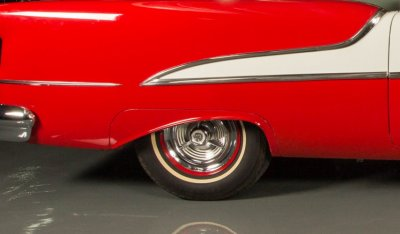 Oldsmobile 88 1956 rear wheel closeup view